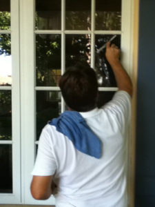 A Pane-less solution tech cleaning windows in Boca Raton, FL.